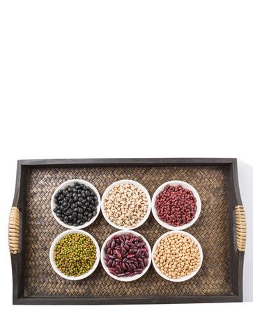 aduki bean: Black eye peas mung bean adzuki beans soy beans black beans and red kidney beans in white bowl on wicker tray Stock Photo