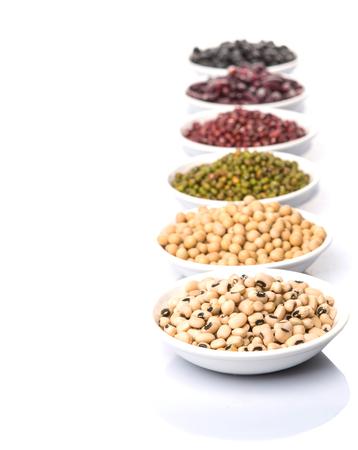 Black eye peas mung bean adzuki beans chickpeas soy beans black beans and red kidney beans in white bowl over white background