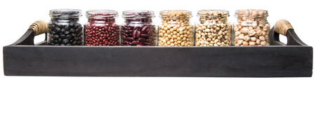 aduki bean: Black eye peas chickpeas adzuki beans soy beans black beans and red kidney beans in mason jars on wicker tray Stock Photo