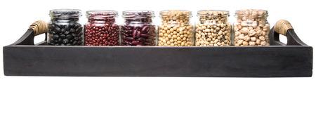 aduki bean: Black eye peas chickpeas adzuki beans soy beans black beans and red kidney beans in mason jars on wicker tray Stock Photo