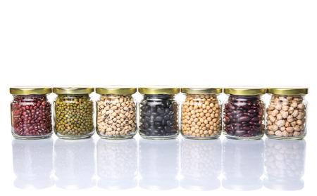 aduki bean: Black eye peas chickpeas adzuki beans mung bean soy beans black beans and red kidney beans in mason jars over white background Stock Photo