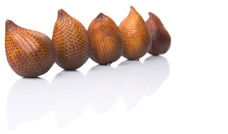 salak: Salak fruit or snake fruits over white background Stock Photo