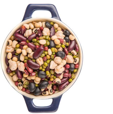 aduki bean: Mix beans of black eye peas mung bean adzuki beans soy beans black beans and red kidney beans in a blue pot over white background Stock Photo