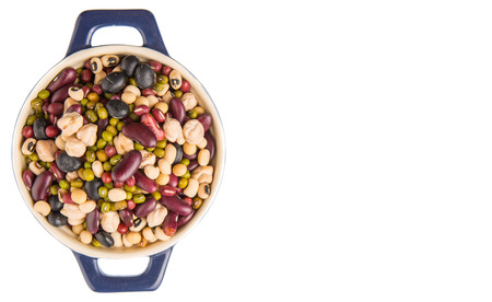 adzuki bean: Mix beans of black eye peas mung bean adzuki beans soy beans black beans and red kidney beans in a blue pot over white background Stock Photo