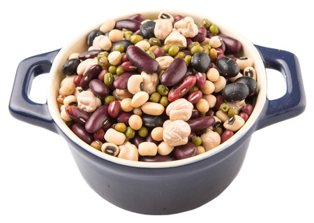 aduki bean: Mix beans of black eye peas mung bean adzuki beans soy beans black beans and red kidney beans in a blue pot over white background Stock Photo