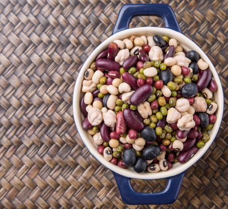 aduki bean: Mix beans of black eye peas mung bean adzuki beans soy beans black beans and red kidney beans in a blue pot over wicker background