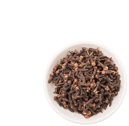 clove: Clove spices in white bowl over white background
