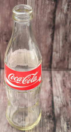 cola bottle: PUTRAJAYA, MALAYSIA - JULY 2ND, 2015. Empty Coca Cola bottle. Coca Cola drinks are produced and manufactured by The Coca-Cola Company, an American multinational beverage corporation.