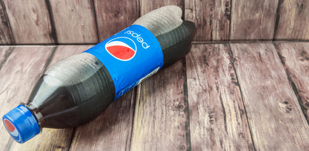 carbonated drink: PUTRAJAYA, MALAYSIA - 2ND JULY, 2015. Pepsi soft drink. Pepsi is a carbonated soft drink produced and manufactured by PepsiCo Inc. an American multinational food and beverage company.