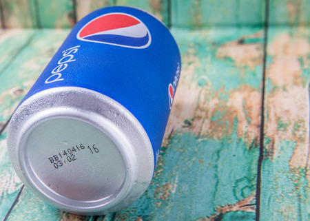 carbonated: PUTRAJAYA, MALAYSIA - JULY 5TH, 2015. Pepsi can on weathered wood. Pepsi is a carbonated soft drink produced and manufactured by PepsiCo Inc. an American multinational food and beverage company. Editorial
