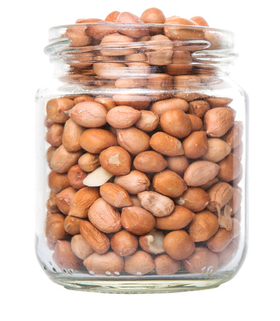earthnuts: Peanuts or ground nuts in a mason jar over white background