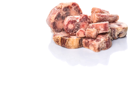 red skinned: Raw frozen ox tail on white background Stock Photo