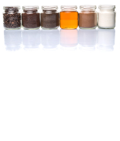 chocolate powder: Coffee beans, powdered coffee, honey, chocolate powder and processed tea leaves beverages in mason jars over white background Stock Photo