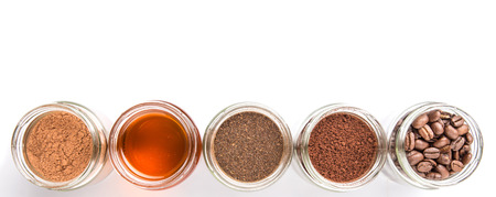 chocolate powder: Coffee beans, powdered coffee, honey, chocolate powder and processed tea leaves beverages mason jars over white background Stock Photo