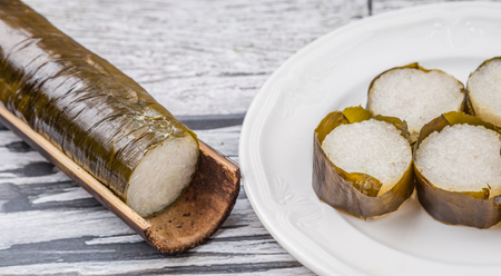 malaysia culture: Lemang is a traditional Malay dish of glutinous rice mix with coconut milk wrapped in banana leaves and cooked in bamboo Stock Photo