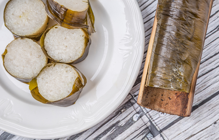 Lemang is a traditional Malay dish of glutinous rice mix with coconut milk wrapped in banana leaves and cooked in bamboo Stock Photo