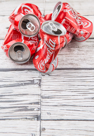 cola canette: PUTRAJAYA, MALAYSIA - JULY 14TH, 2015. Crumpled Coca Cola cans. Coca Cola drinks are produced and manufactured by The Coca-Cola Company, an American multinational beverage corporation.