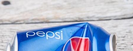 carbonated: PUTRAJAYA, MALAYSIA - JULY 14TH, 2015. Crumpled Pepsi can. Pepsi is a carbonated soft drink produced and manufactured by PepsiCo Inc. an American multinational food and beverage company.