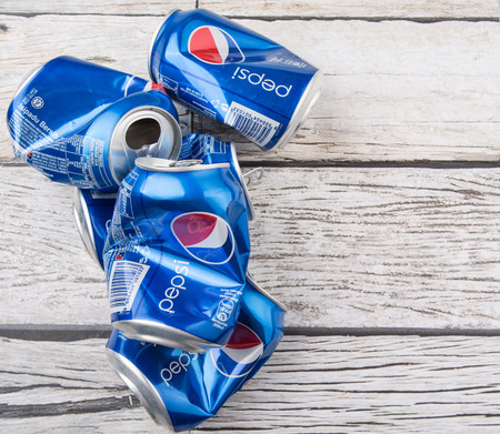 carbonated drink: PUTRAJAYA, MALAYSIA - JULY 14TH, 2015. Crumpled Pepsi can. Pepsi is a carbonated soft drink produced and manufactured by PepsiCo Inc. an American multinational food and beverage company.