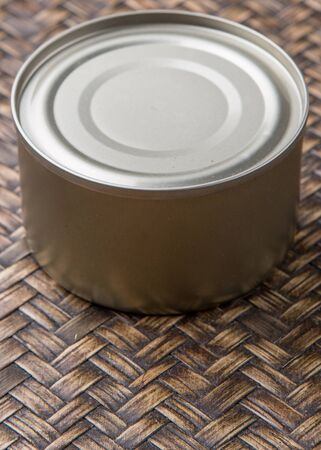 aluminum can: Short aluminum can over wicker background Stock Photo