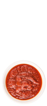 pureed: Fresh pureed tomato in white bowl over white background