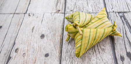 malaysia culture: Malay dish ketupat daun palas or rice dumpling where glutinous rice is wrapped in a triangular shape using the leaves of the fan palm Stock Photo