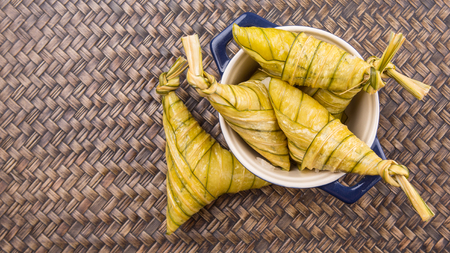 Malay dish ketupat daun palas or rice dumpling where glutinous rice is wrapped in a triangular shape using the leaves of the fan palm