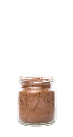 calorie rich food: Brown pure cocoa powder in a mason jar over white background Stock Photo