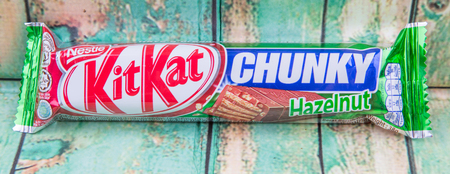 acquired: PUTRAJAYA, MALAYSIA, JULY 21ST, 2015. Kit Kat is a chocolate covered wafer bar created in 1911 by Rowntrees of York, England. Nestle which acquired Rowntree in 1988 now sells Kit Kat globally.