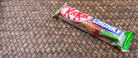 globally: PUTRAJAYA, MALAYSIA, JULY 21ST, 2015. Kit Kat is a chocolate covered wafer bar created in 1911 by Rowntrees of York, England. Nestle which acquired Rowntree in 1988 now sells Kit Kat globally.