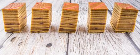 lapis: Malaysian dish Kek Lapis Sarawak or Sarawak layered cake over wooden background