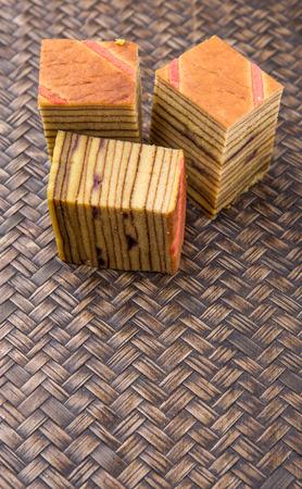 lapis: Malaysian dish Kek Lapis Sarawak or Sarawak layered cake over wicker background