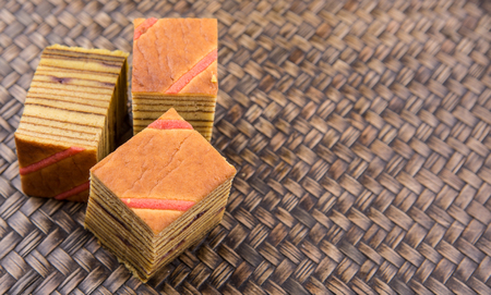 lapis: Malaysian dish Kek Lapis Sarawak or Sarawak layered cake over wicker background