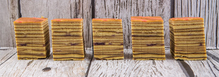 lapis: Malaysian dish Kek Lapis Sarawak or Sarawak layered cake over wooden background