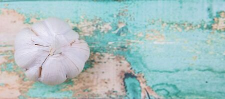 clove: A clove of garlic over rustic wooden background