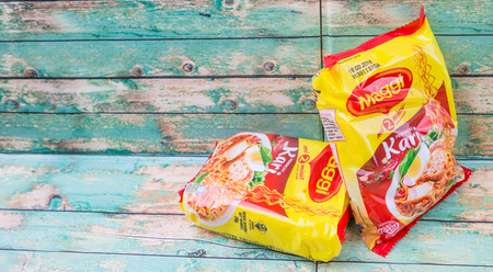 nestle: KUALA LUMPUR, MALAYSIA - MARCH 15TH 2015. Maggi instant noodles. Owned by Nestle, Maggi is an international brand of soups, stocks, bouillon cubes, ketchups, sauces, seasonings and instant noodles.