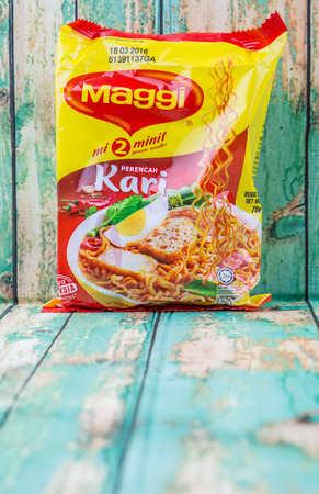 owned: PUTRAJAYA, MALAYSIA - JULY 24TH, 2015. Maggi instant noodles. Owned by Nestle, Maggi is an international brand of soups, stocks, bouillon cubes, ketchups, sauces, seasonings and instant noodles. Editorial