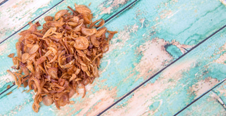 smells: Deep fried shallots for garnishing over wooden background