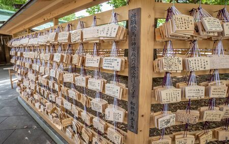 ema: TOKYO, JAPAN - AUGUST 16TH 2015. Prayers written on wooden card called ema in Japanese language at the Meiji Shinto Shrine, Shibuya, Japan. Editorial