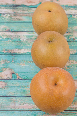 asian pear: Asian pear, also known as Nashi pear over wooden background