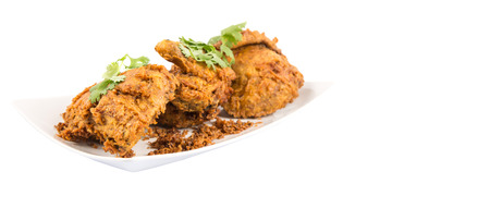 javanese: Popular Javanese dish Ayam Penyet or crispy fried chicken in a white plate