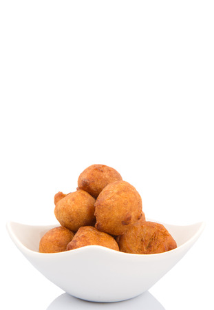 balls deep: Popular Malaysian fritter snack deep fried banana balls or locally known as Cekodok Pisang over white background Stock Photo