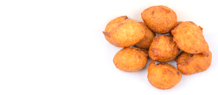 fritter: Popular Malaysian fritter snack deep fried banana balls or locally known as Cekodok Pisang over white background Stock Photo