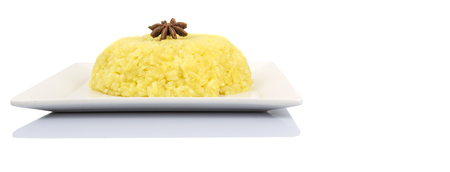 free dish: Malaysian dish Yellow Glutinous Rice or locally known as Pulut Kuning on white plate Stock Photo