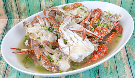 oblong: Malaysian dish clear crab soup in an oblong plate over wooden background