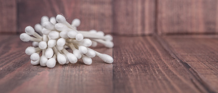 cotton swab: White cotton bud or cotton swab over wooden background