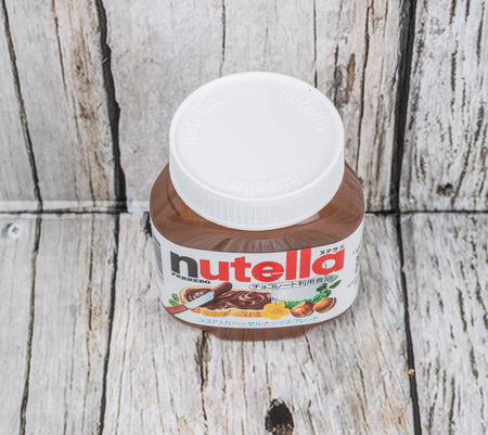 ferrero: TOKYO, JAPAN - 2ND OCTOBER, 2015. First introduced in 1964 Nutella is the brand name of an Italian sweetened hazelnut chocolate spread and manufactured by the Italian company Ferrero.