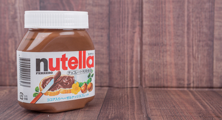 introduced: TOKYO, JAPAN - 2ND OCTOBER, 2015. First introduced in 1964 Nutella is the brand name of an Italian sweetened hazelnut chocolate spread and manufactured by the Italian company Ferrero.