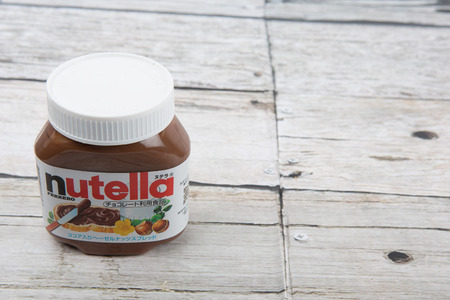 nutella: TOKYO, JAPAN - 2ND OCTOBER, 2015. First introduced in 1964 Nutella is the brand name of an Italian sweetened hazelnut chocolate spread and manufactured by the Italian company Ferrero.