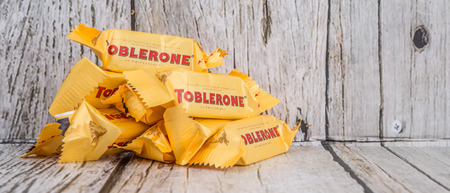 toblerone: TOKYO, JAPAN - 4TH OCTOBER 2015. Created by Theodor Tobler in 1908, Toblerone is a Swiss triangular chocolate bar brand owned by American Mondelez International. Editorial